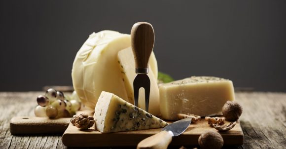 Cheese and grape on wooden table